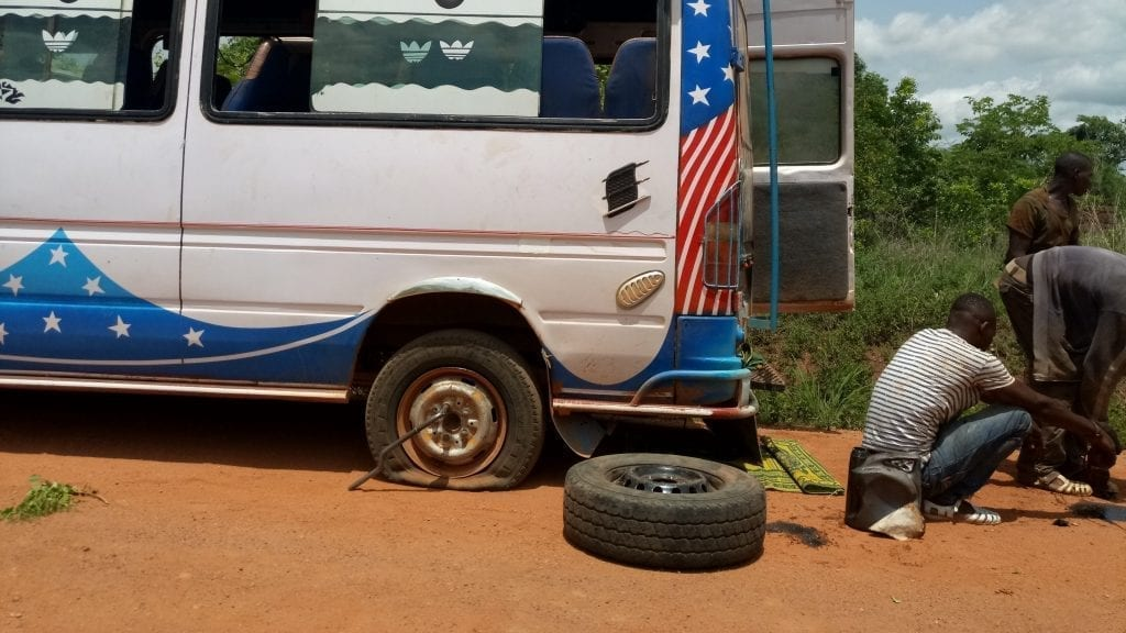 Ivory Coast minibus flat tire