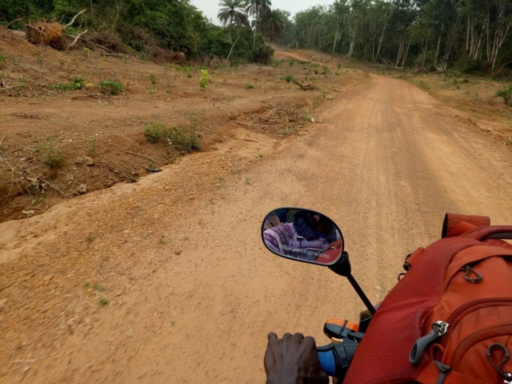 Osprey Porter pack on motorbike taxi Sierra Leone Liberia border road
