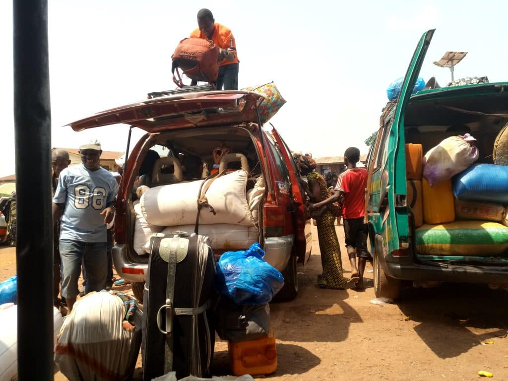 My backpack being loaded on the roof of a shared taxi in Makeni, Sierra Leone