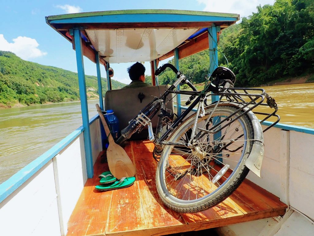 Touring bicycle in slow boat in Laos