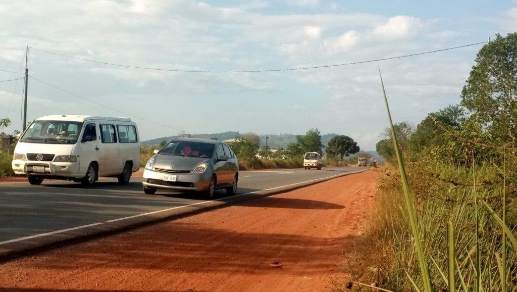 Car overtaking van on Cambodia's highway 4