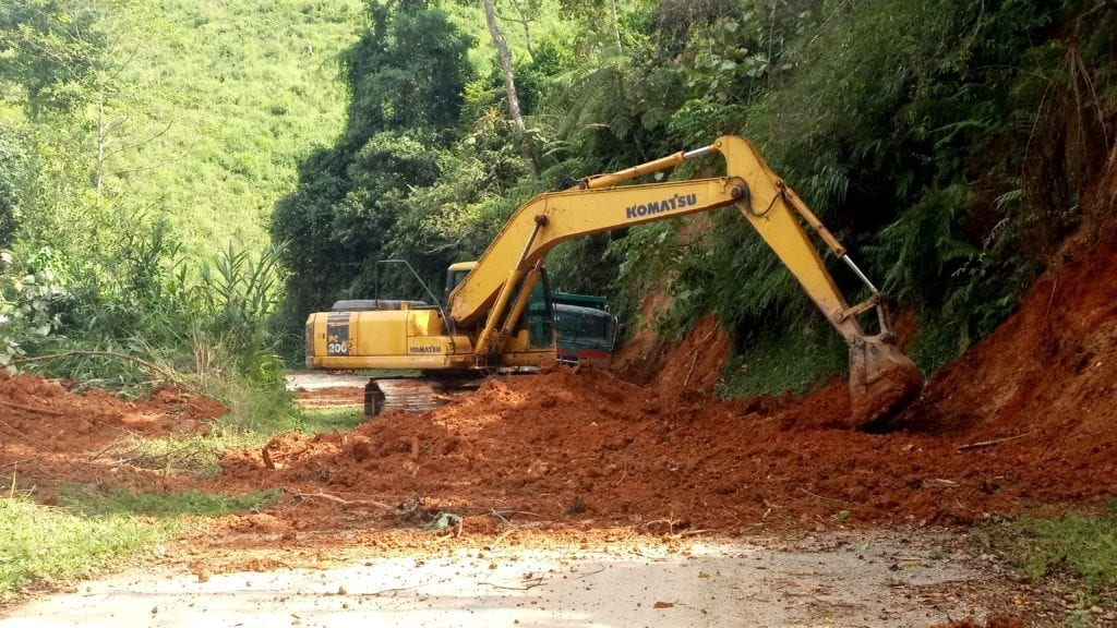 Machinery clearing a landslide on Laos highway