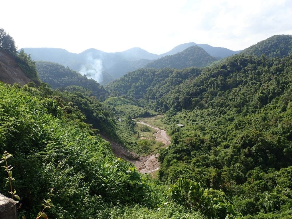 Green valley with mountains in Laos