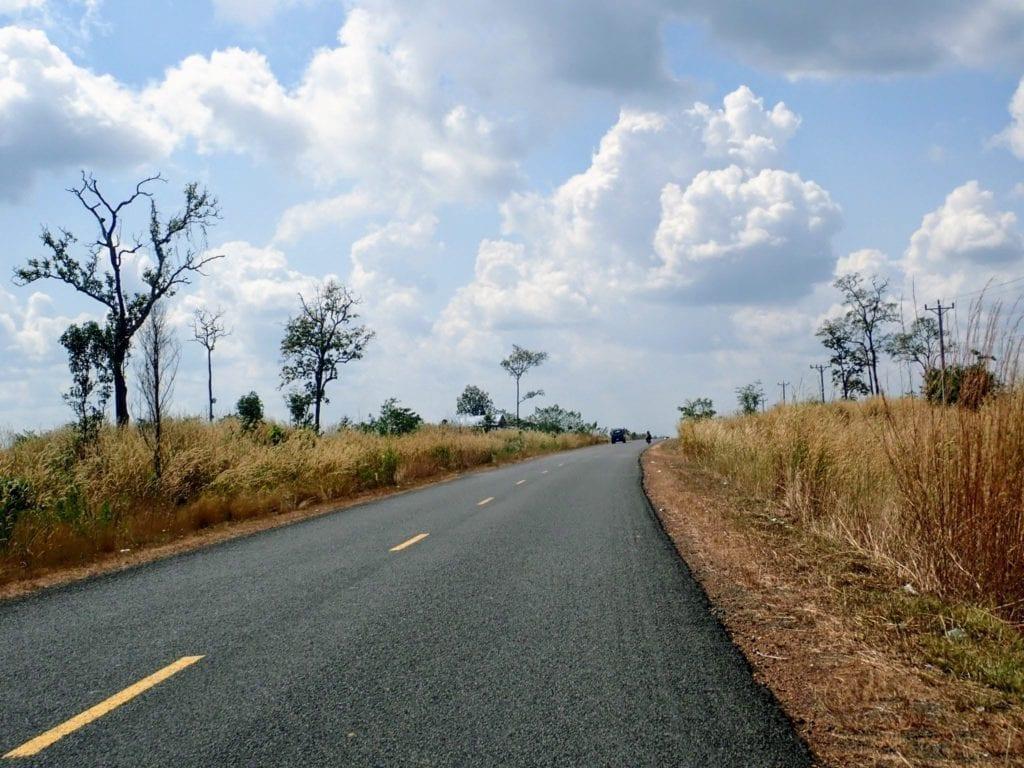 Open road through grassland in northern Cambodia