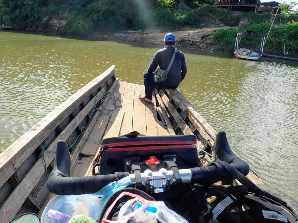 View from bicycle on small ferry in southern Laos