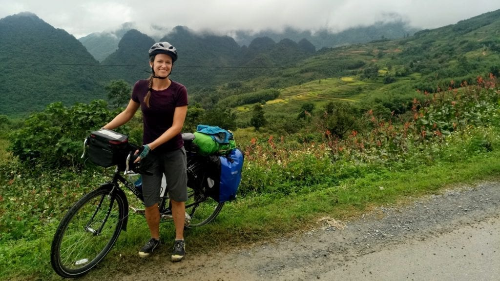 Woman with bicycle in Vietnam mountains