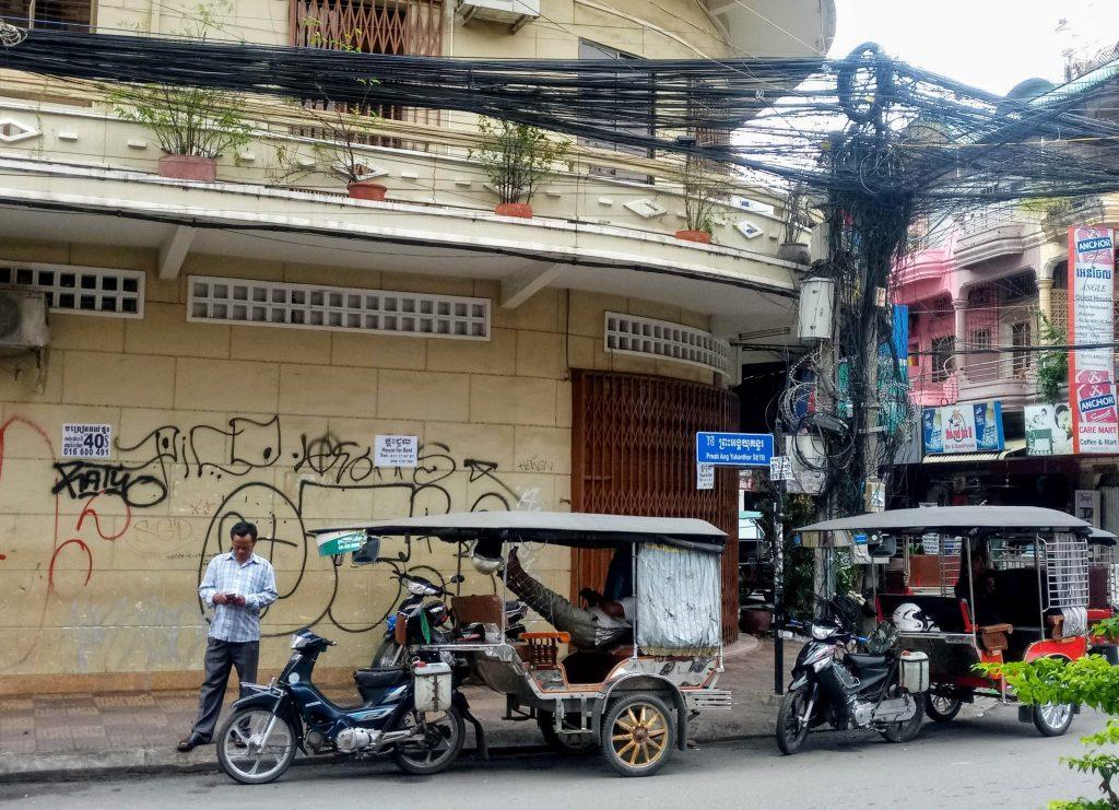 Tuk tuk drivers waiting for fares in Phnom Penh