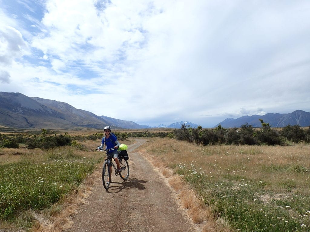 Bicycle touring on dirt road in New Zealand