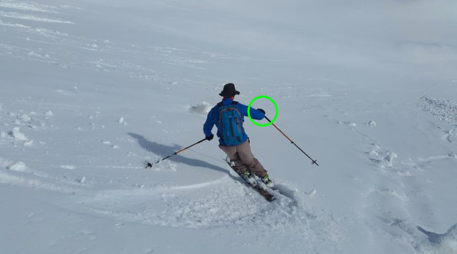 Ski tips for intermediates: backcountry skier with hand out in front, ready to plant pole.