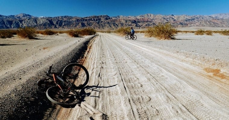Mountain biking up sandy road in Death Valley National Park