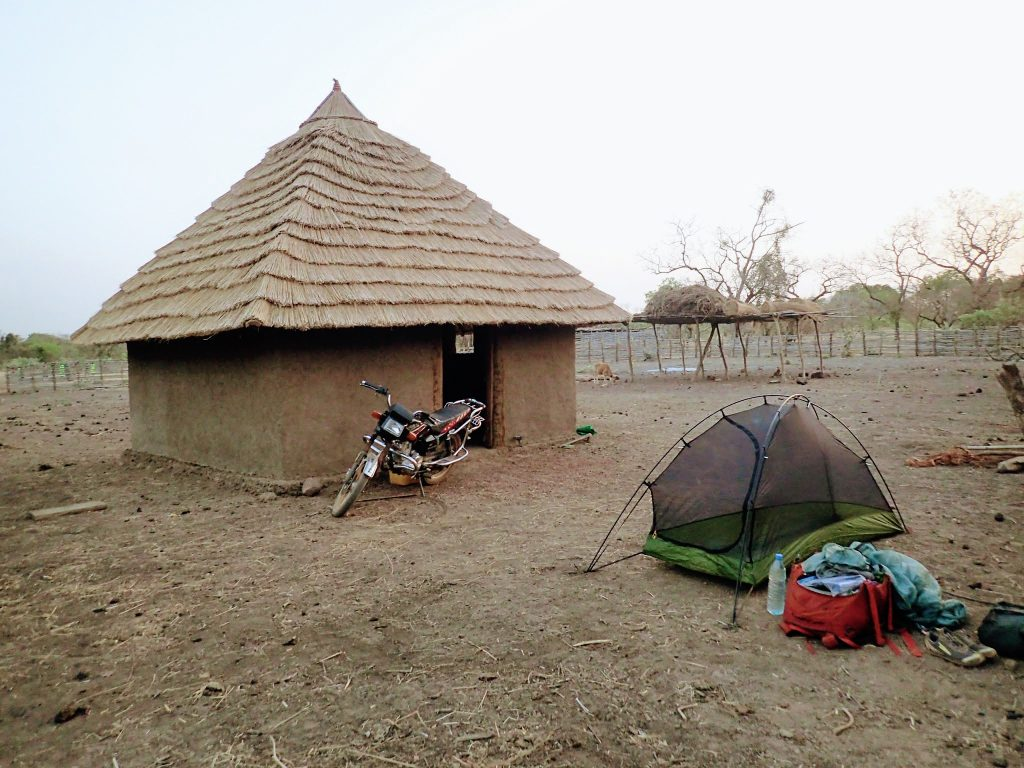 Big Sky Soul tent pitched next to hut in a remote Guinean village