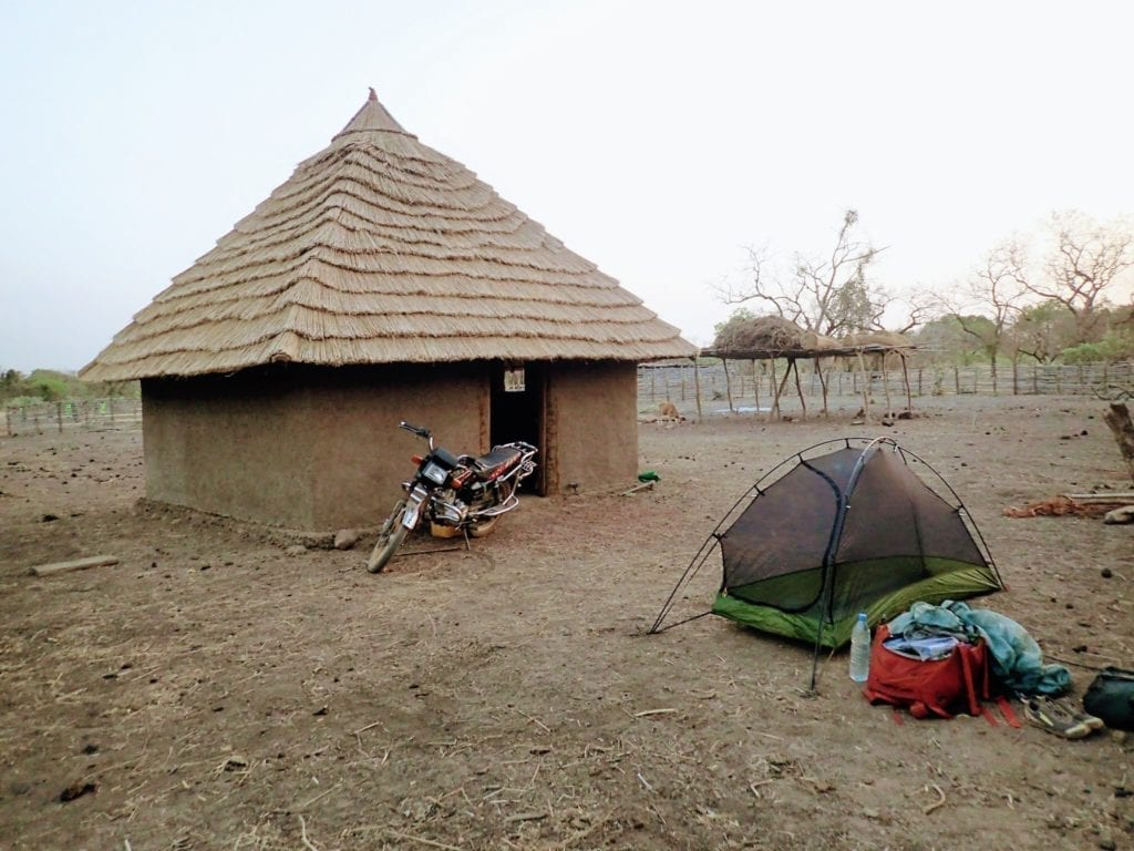 Camping next to hut in Guinean highlands
