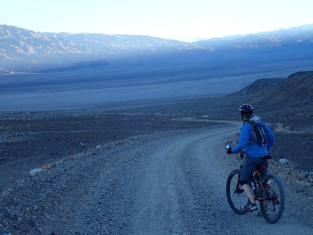 Mountain biker at dusk on Cottonwood Canyon road