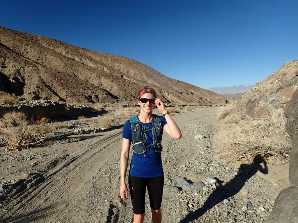 Trail runner on sandy canyon road in Death Valley