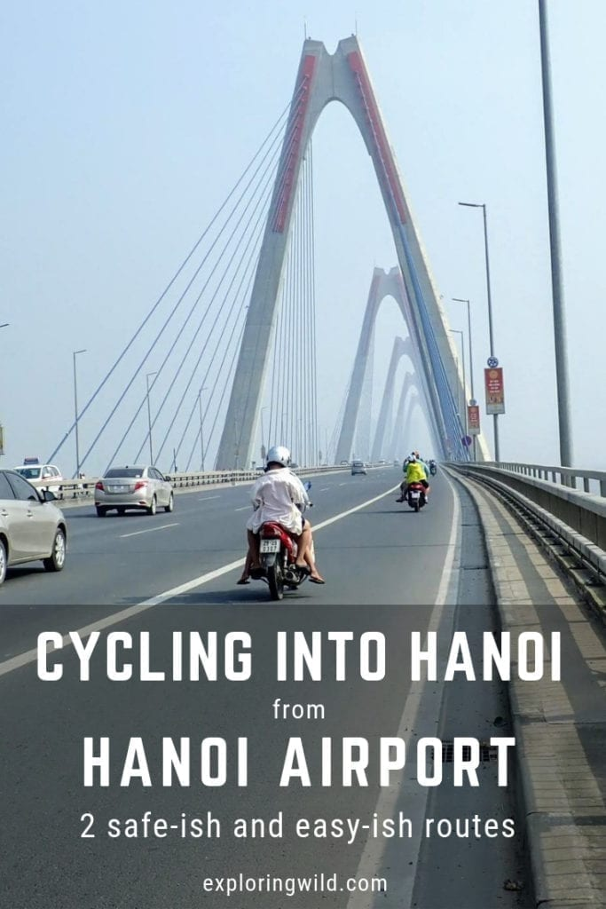Riding over bridge in Hanoi with text overlay: cycling into Hanoi from Hanoi Airport: 2 safeish and easyish routes