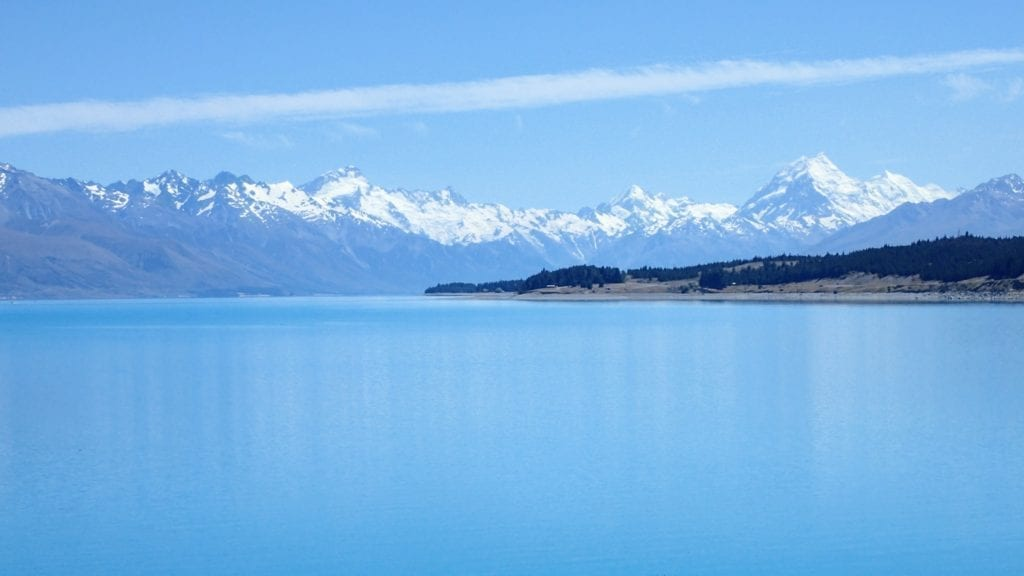 Blue lake in New Zealand with Mt. Cook in the distance.