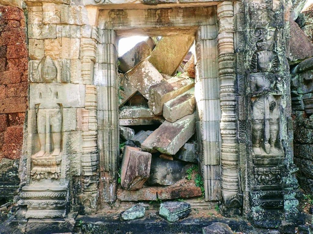 Ruined doorway full of stone blocks at Preah Khan temple