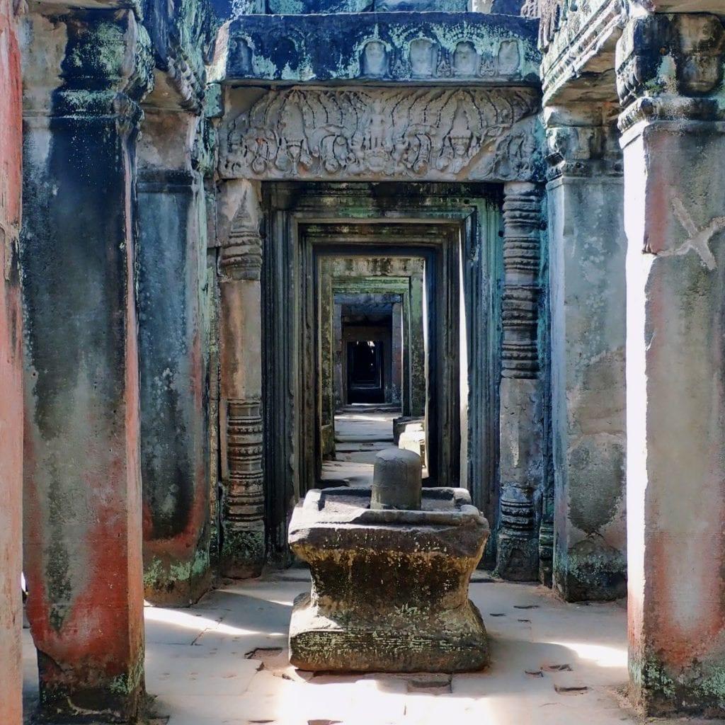 Stone linga statue in long corridor of doorways at Preah Khan temple