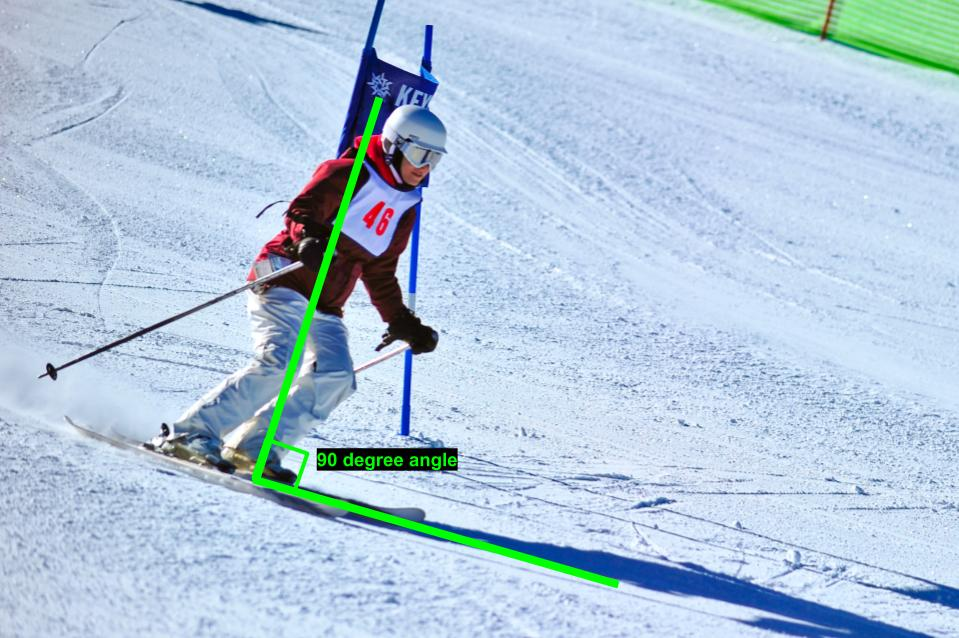 Ski tips for intermediates: woman leans forward correctly while downhill skiing
