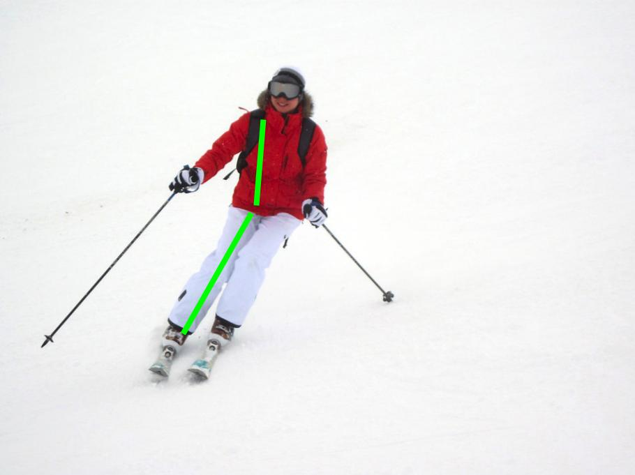 Ski tips for intermediates: skier shows angulation at the hip