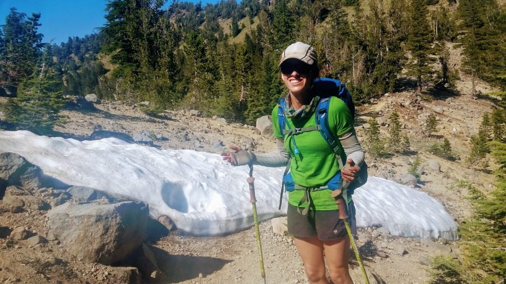 Hiker encounters small snow patch on Tahoe Rim Trail in summer