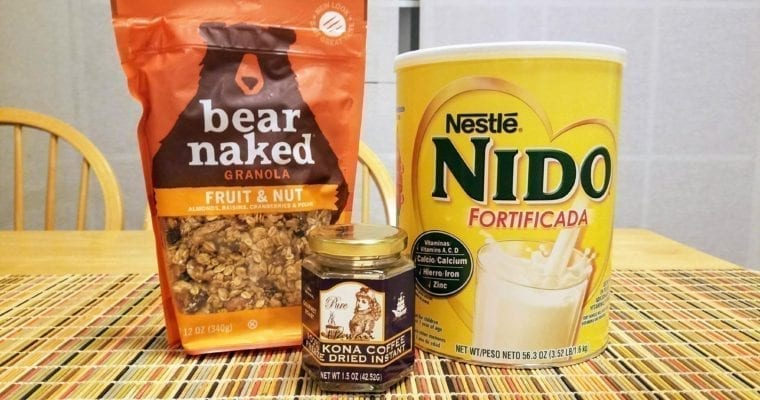 Bag of granola, large can of Nido powdered milk and jar of instant coffee