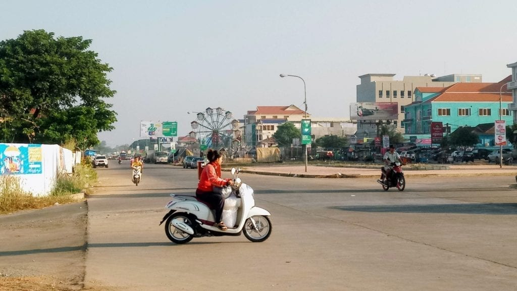 Motorbikes on wide paved streets in Stung Treng, Cambodia