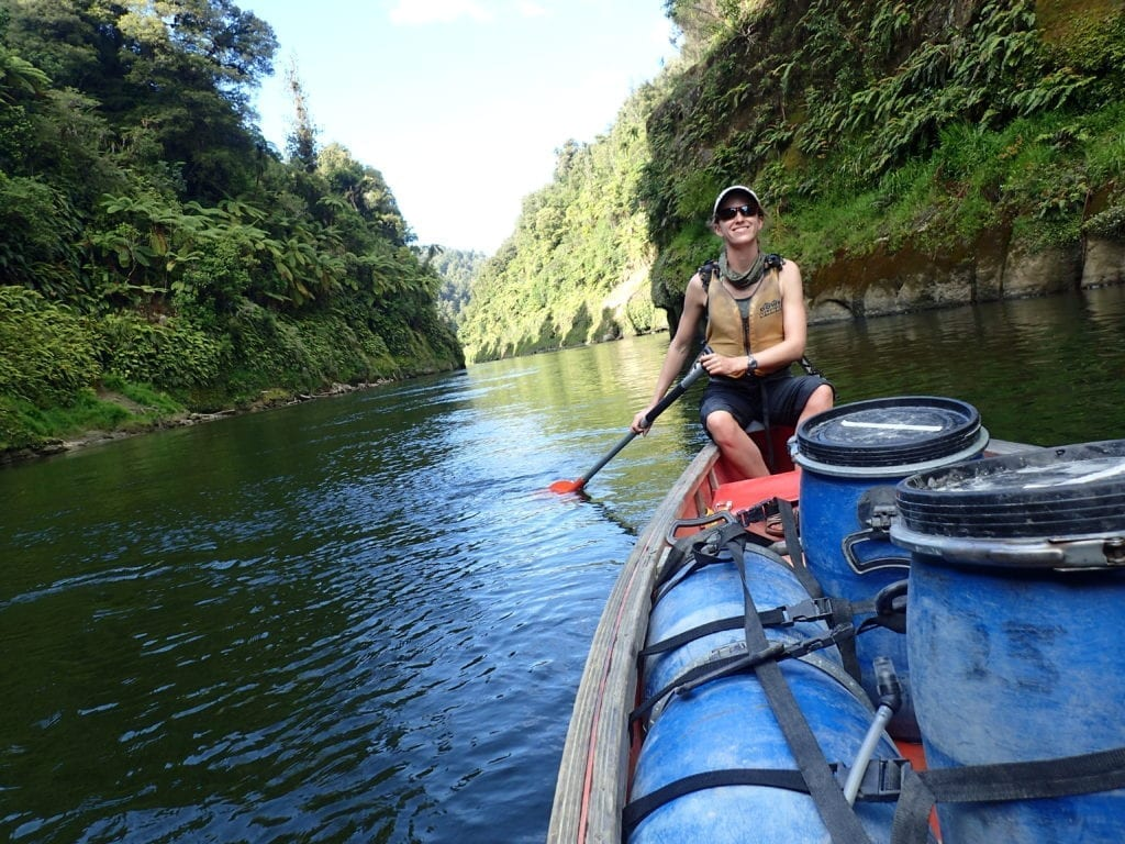 Woman paddling canoe on the Whanganui River