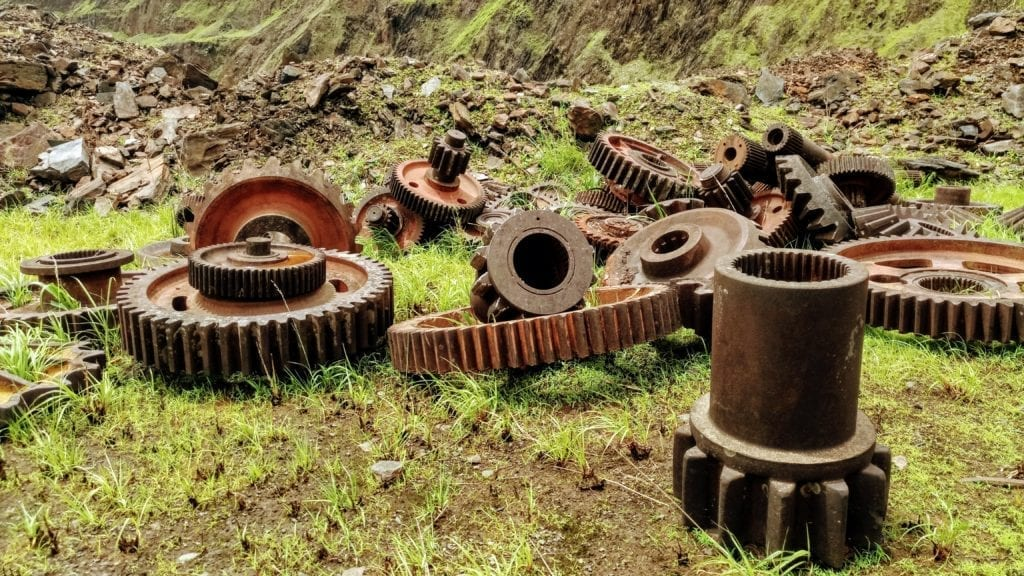 Big gears and machinery parts from abandoned mining equipment on Mt Nimba