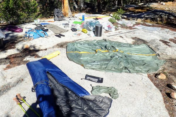 Backpacking gear drying on rock