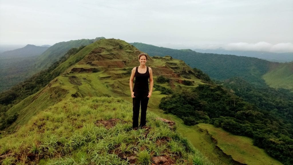 Female tourist hikes ridgeline of Mt Nimba in Liberia