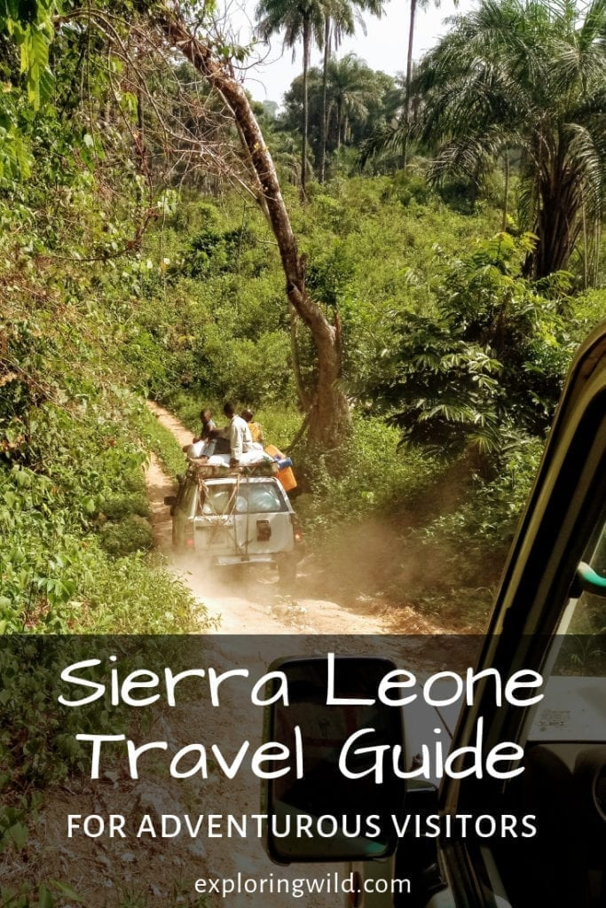 Bush taxi on rough dirt road through jungle, with text overlay: Sierra Leone Travel Guide for adventurous visitors.