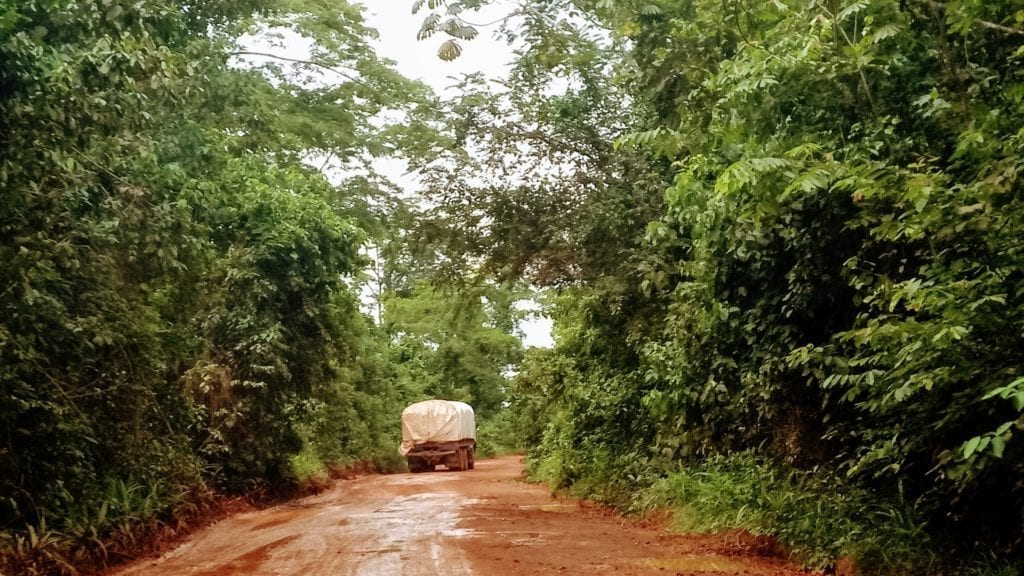 Truck on muddy dirt road in Liberia