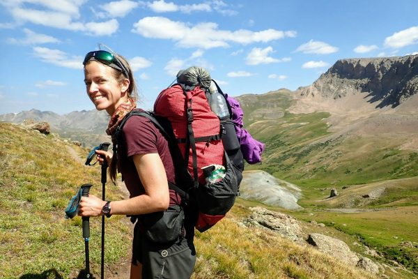 Hiker wears lightweight backpack on Colorado Trail