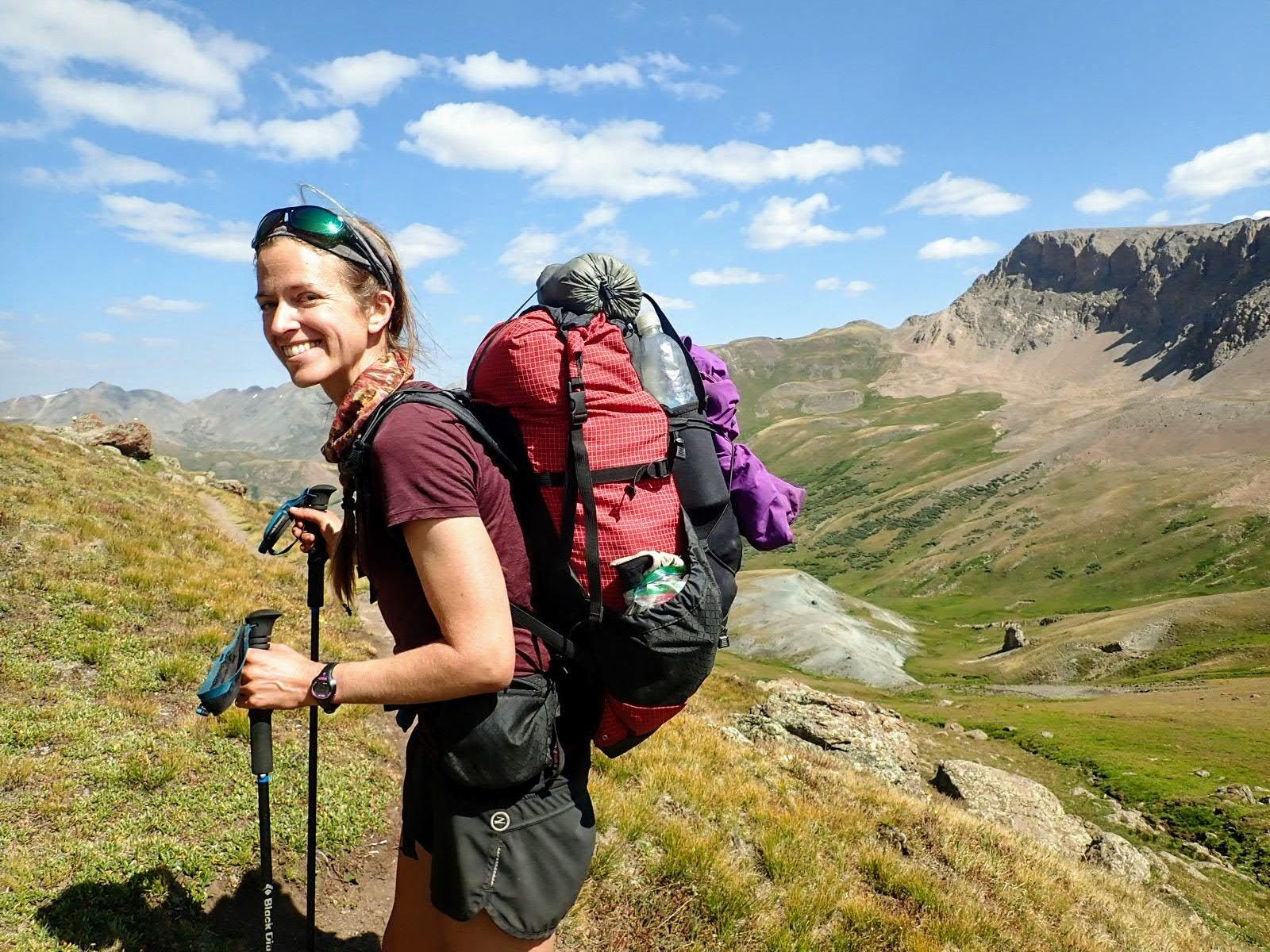 Hiker wears lightweight backpack on Colorado Trail