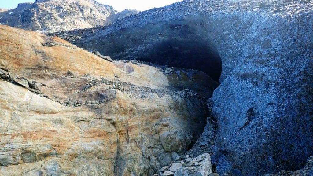 Small ice cave where Vinciguerra Glacier meets rock
