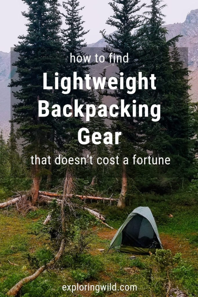 Picture of a tent in a wooded mountain campsite with text overlay: How to find lightweight backpacking gear that doesn't cost a fortune