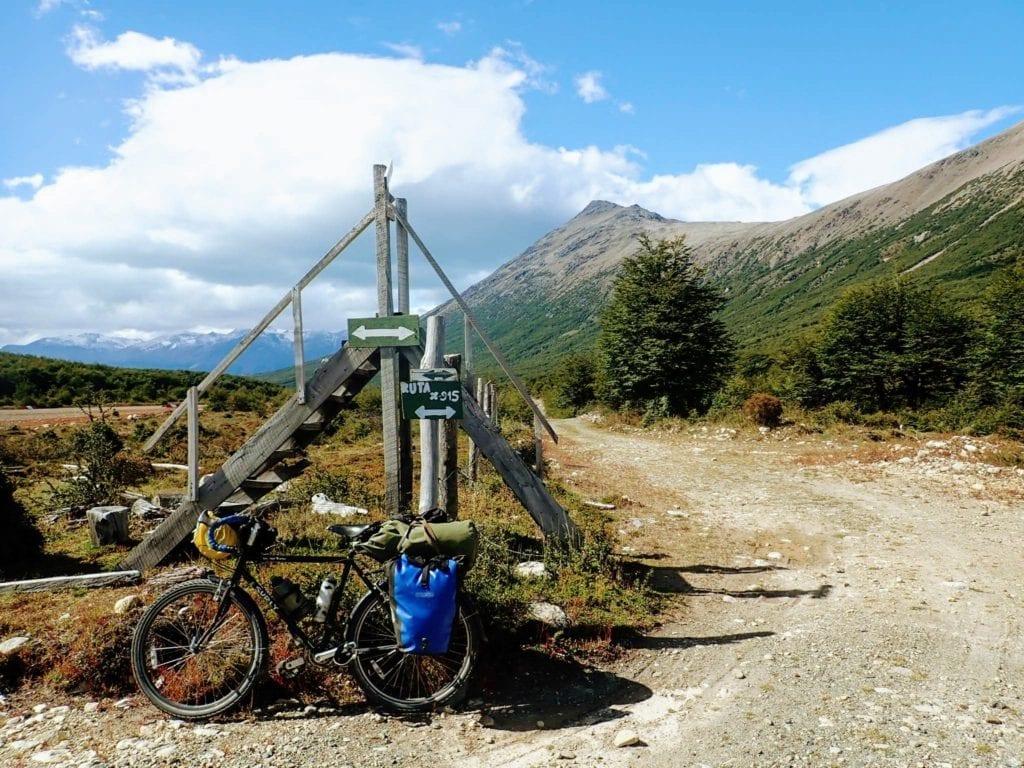 Bicycle at rural highway sign in Patagonia
