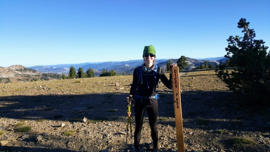 Female hiker at Dick's Pass trail marker on Tahoe Rim Trail