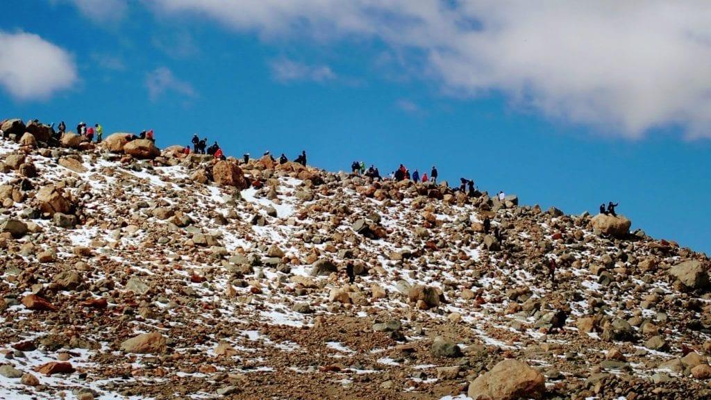 Hikers on rocky ridgeline near Laguna de los Tres, Argentina