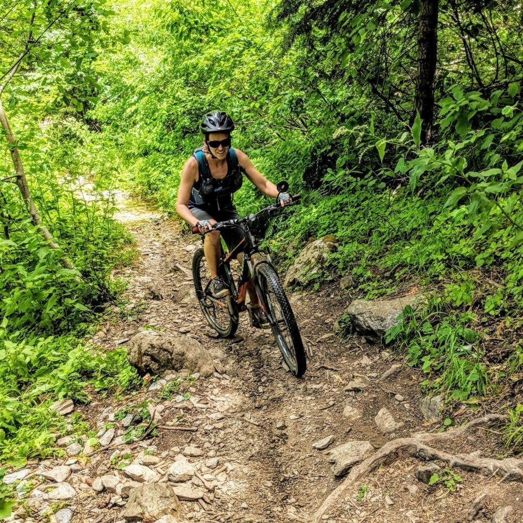 Female mountain biker on Downieville downhill course