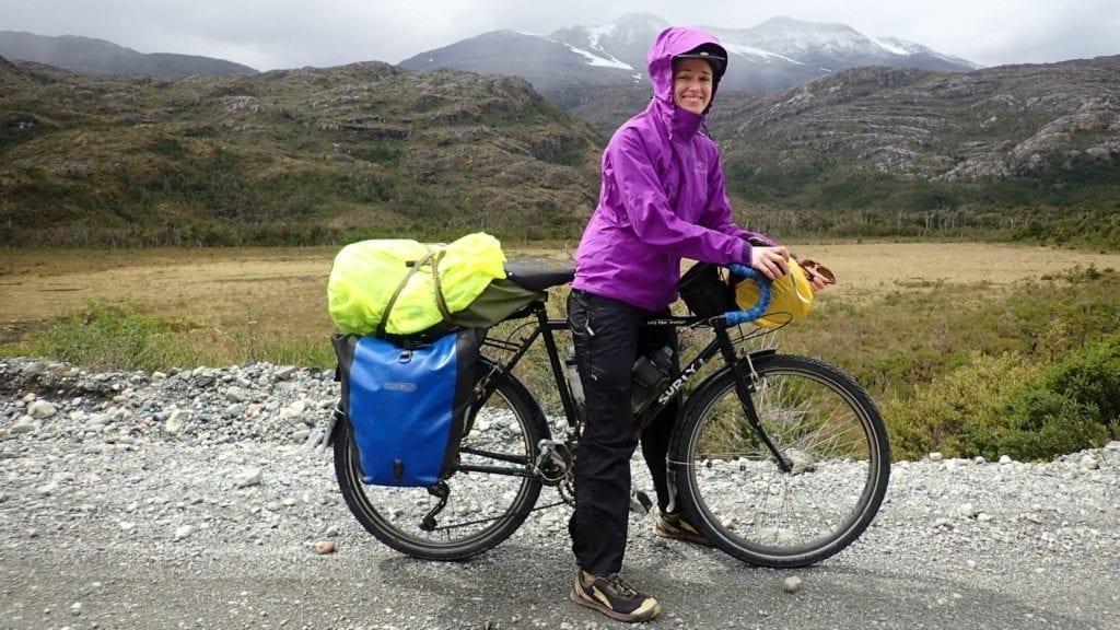 Cyclist wearing White Sierra Trabagon rain pants on the Carretera Austral
