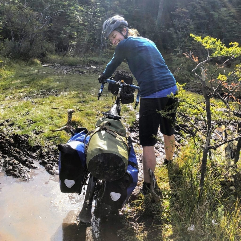 Touring cyclist in mud in Patagonia