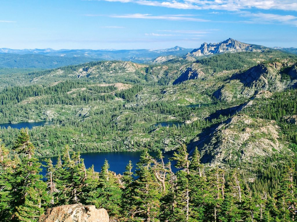 View of granite mountains and alpine lakes from Mount Elwell