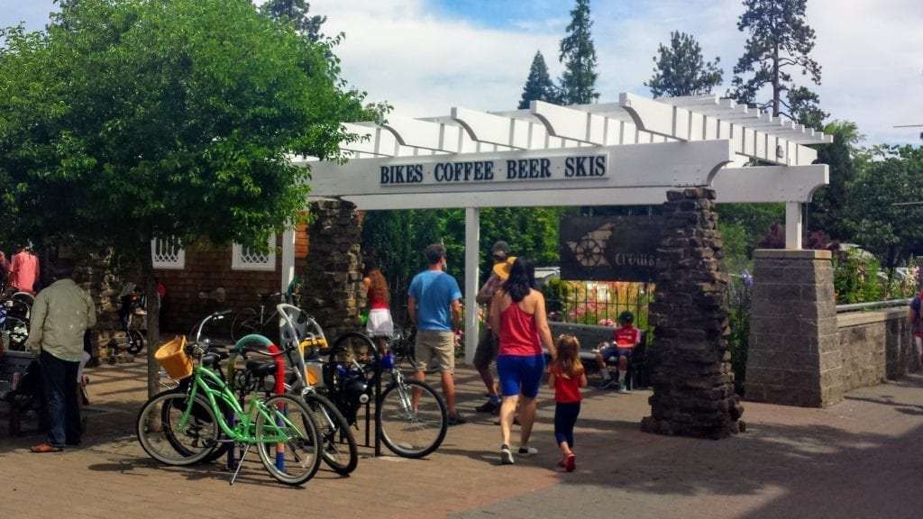 Street in Bend, Oregon with sign that says Bikes, Coffee, Beer, Skis