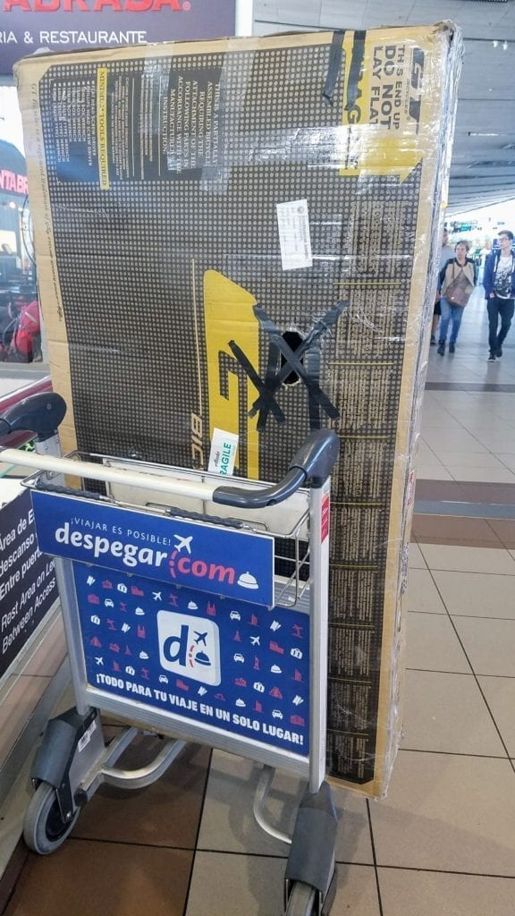 Bicycle box on luggage cart in airport