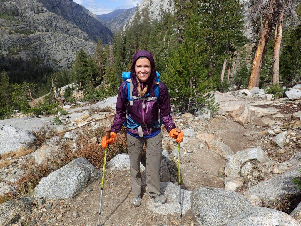 Hiker on John Muir Trail wearing purple Helium II rain jacket