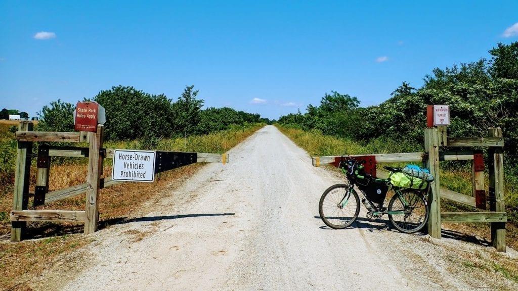 Bicycle at trailhead to prairie section of Missouri's Katy Trail rail trail