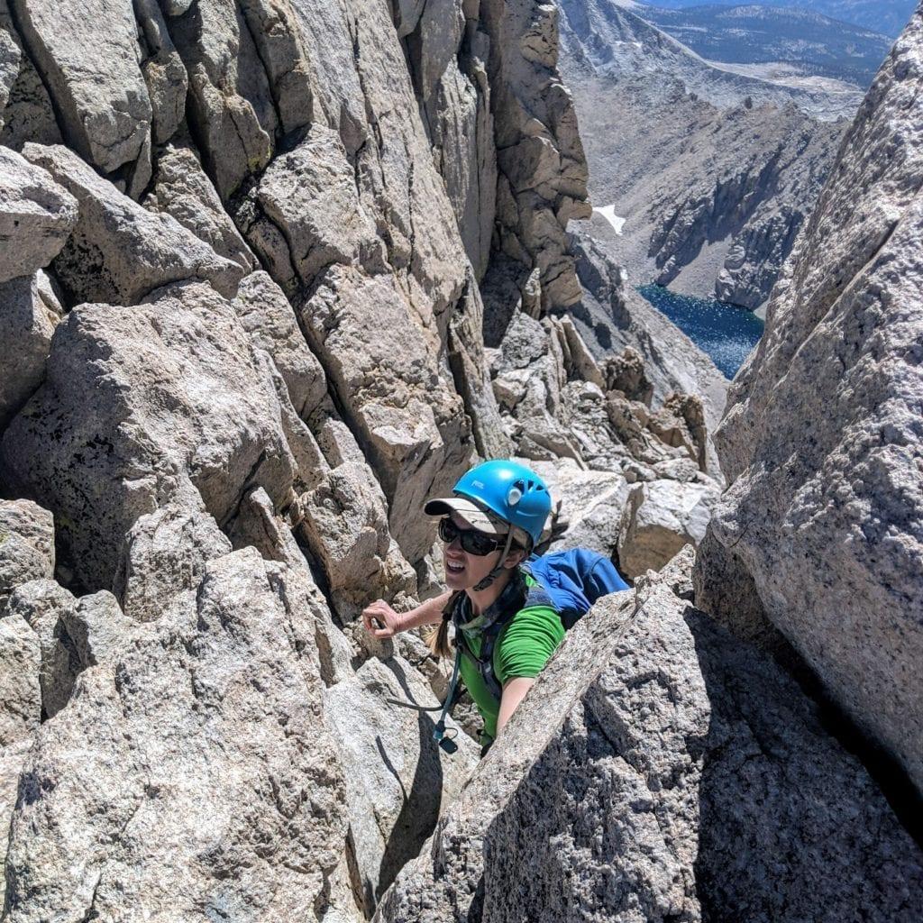 Climber navigates chimney scramble on Mount Williamson
