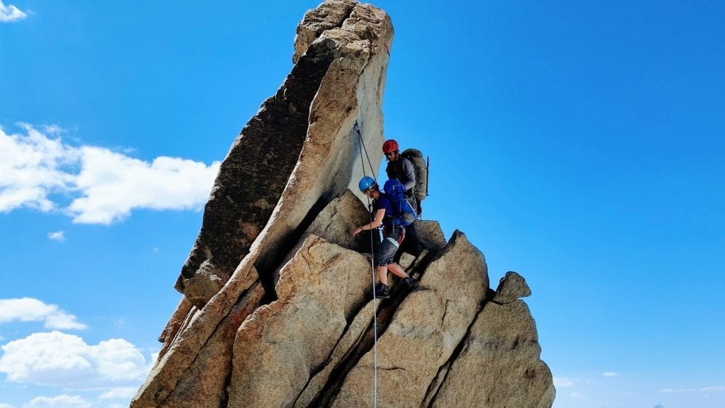 Climber downclimbing class 4 with a guide in the Palisade range